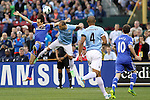 23 May 2013:  Pablo Zabaleta (center right)(ARG) of Manchester City competes  for a headball against Yossi Benayoun (left)(ISR) of Chelsea.  Chelsea F.C. was defeated by Manchester City 3-4 at Busch Stadium in Saint Louis, Missouri, in a friendly exhibition soccer match.