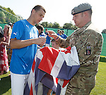 Lee McCulloch autographs a squaddie's flag
