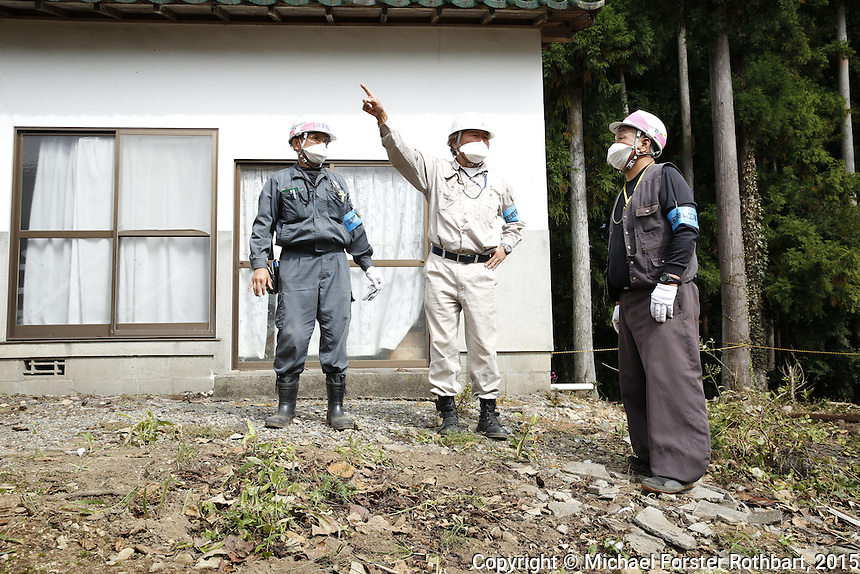 Ben Takeda, a Fukushima decontamination supervisor working for the Joint Venture in Tomioka, Japan, in the Fukushima Exclusion Zone, checks in with laborers working to decontaminate homes and commercial properties. Almost all developed properties in Tomioka are now getting cleaned or demolished four and a half years after the Fukushima Daiichi nuclear power plant disaster. Full caption to come.<br /> <br /> &copy; Michael Forster Rothbart Photography<br /> www.mfrphoto.com &bull; 607-267-4893<br /> 34 Spruce St, Oneonta, NY 13820<br /> 86 Three Mile Pond Rd, Vassalboro, ME 04989<br /> info@mfrphoto.com<br /> Photo by: Michael Forster Rothbart<br /> Date:  10/6/2015<br /> File#:  Canon &mdash; Canon EOS 5D Mark III digital camera frame B20535