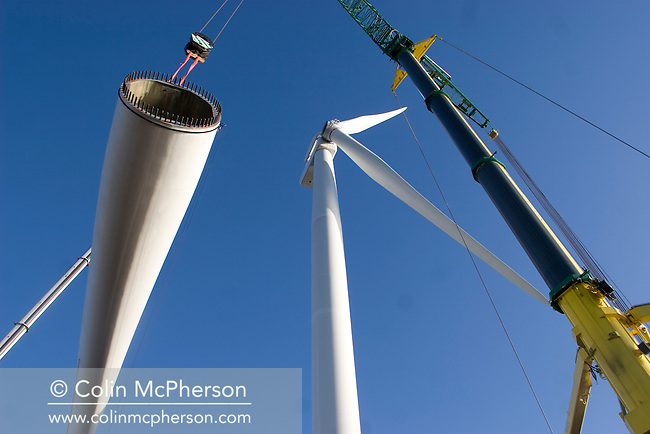 The last remaining 11 tonne blade on a 2.5 megawatt wind turbine at Alexandra Dock in Liverpool is lifted into place by cranes. The month-long operation was undertaken by the docks' owners, Peel Holdings, and was a £15m investment which will generate power for the docks and around 5500 nearby homes. The 80m towers and 45m blades weigh 350 tonnes and were assembled by a team from Germany after arriving in sections from the manufacturers in Rostock..