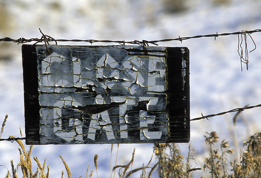 Close Gate sign hanging from barbed wire fence, Yakima River Canyon, Yakima, Washington