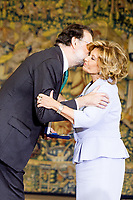 Spanish Prime minister Mariano Rajoy delivers the work medal to Maria Teresa Campos