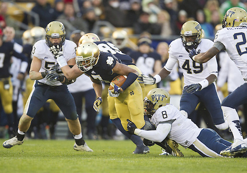 November 03, 2012:  Pittsburgh linebacker Todd Thomas (8) tackles Notre Dame wide receiver TJ Jones (7) during NCAA Football game action between the Notre Dame Fighting Irish and the Pittsburgh Panthers at Notre Dame Stadium in South Bend, Indiana.  Notre Dame defeated Pittsburgh 29-26 in three overtimes.