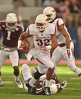 STAFF PHOTO BEN GOFF  @NWABenGoff -- 09/27/14  Arkansas running back Jonathan Williams carries the ball during the fourth quarter of the Southwest Classic in AT&T Stadium in Arlington, Texas on Saturday September 27, 2014.