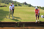 Graeme McDowell droping his ball after putting his ball in the water on the 5th, Two practice drops ended in his balls going in the water on day two of the Celtic Manor wales Open 2010.Picture Fran Caffrey/Newsfile.ie