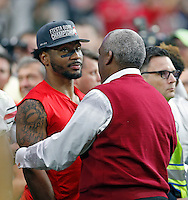Ohio State Buckeyes wide receiver Braxton Miller (1) gets a hug from athletic director Gene Smith after Ohio State Buckeyes beat Notre Dame Fighting Irish during the Fiesta Bowl in the University of Phoenix Stadium on January 1, 2016.  (Dispatch photo by Kyle Robertson)