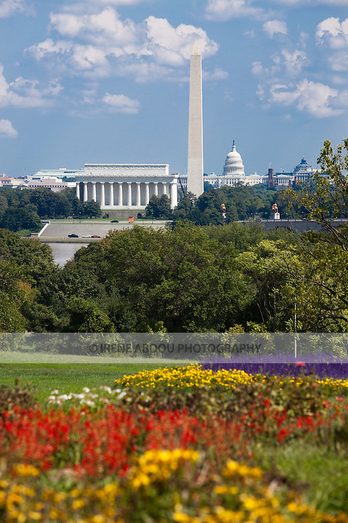 View of the Washington Monument, Lincoln Memorial, and U.S. Capitol building from the gardens of the Netherlands Carillon in Arlington, Virginia.
