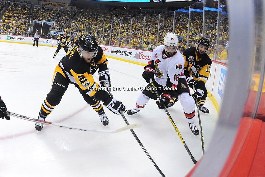 May 15, 2017: Pittsburgh Penguins defenseman Chad Ruhwedel (2) and Ottawa Senators left wing Clarke MacArthur (16) battle for the puck at the boards during game two of the National Hockey League Eastern Conference Finals between the Ottawa Senators and the Pittsburgh Penguins, held at PPG Paints Arena, in Pittsburgh, PA. Pittsburgh defeats Ottawa 1-0 in regulation to tie the series 1-1. Eric Canha/CSM