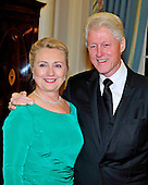 Former United States President Bill Clinton and U.S. Secretary of State Hillary Rodham Clinton pose for a photo as they wait for the seven recipients of the 2012 Kennedy Center Honors to pose for a photo following a dinner hosted by Secretary Clinton at the U.S. Department of State in Washington, D.C. on Saturday, December 1, 2012.  The 2012 honorees are Buddy Guy, actor Dustin Hoffman, late-night host David Letterman, dancer Natalia Makarova, and the British rock band Led Zeppelin (Robert Plant, Jimmy Page, and John Paul Jones)..Credit: Ron Sachs / CNP
