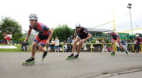 11 AUG 2013 - BIRMINGHAM, GBR - James Ashby (left)  of Wisbech Inline Speed Skating Club leads Sutton Atkins (second from left) of East Midlands Racing and, Wisbech team mates Matt Webster (second from right) and Michael McInerney (right), in the Senior Men's 10,000m Points final during the Federation of Inline Speed Skating 2013 British Outdoor Championships at Birmingham Wheels Park in Birmingham, West Midlands, Great Britain (PHOTO COPYRIGHT © 2013 NIGEL FARROW, ALL RIGHTS RESERVED)