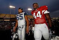 Nov. 6, 2005; Tempe, AZ, USA; Fullback (44) Jarrod Baxter of the Arizona Cardinals talks with linebacker (55) Jamie Sharper of the Seattle Seahawks at Sun Devil Stadium. Mandatory Credit: Mark J. Rebilas