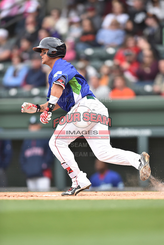 Greenville Drive designated hitter Michael Chavis (11) runs to first during a game against the Asheville Tourists at Fluor Field on April 10, 2016 in Greenville South Carolina. The Drive defeated the Tourists 7-4. (Tony Farlow/Four Seam Images)