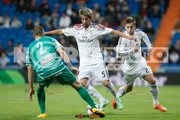 Real Madrid´s Fabio Coentrao (R) and Cornella´s Pere Spanish King Cup match between Real Madrid and Cornella at Santiago Bernabeu stadium in Madrid, Spain.December 2, 2014. (NortePhoto/ALTERPHOTOS/Victor Blanco)