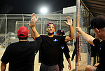 POWAY, CA - JULY 16:  Mitch Letterer is met by teammates in the dugout after his triple and run after an error during the Regular Joe League at the Poway Sportsplex Softball Field on July 16, 2014 in Poway, California. (CREDIT: Donald Miralle for the Wall Street Journal) <br /> chargers