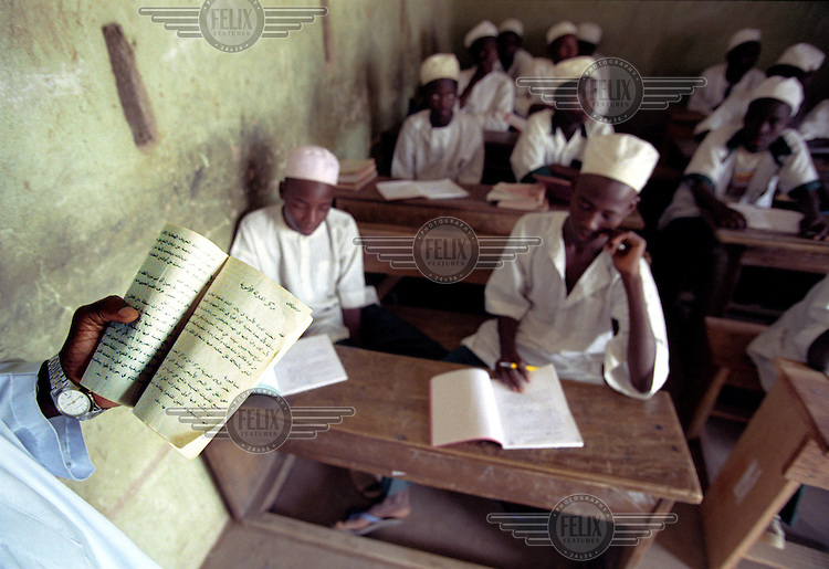 photo: Sven Torfinn.Nigeria, Kano, Kano State, october 2002.Boys in Islamic school where mainly the Arabic language, Islamic religion, standards and values according to the Sharia law are being taught. Boys and girls are being educated seperately..