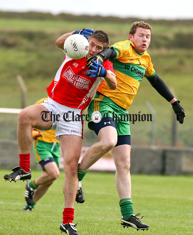030911.Corofins (9) Luke O'Loughlin battles with O'Currys Derek Troy during their Intermediate match at Quilty on Saturday.
