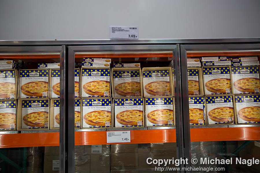 Norman tarts are displayed at a newly opened Costco Wholesale Corp. warehouse in Villebon-Sur-Yvette, France, on Saturday, July 7, 2018. The 150,000-square foot warehouse, which opened last month just outside of Paris, is Costco's first store in France. Costco plans to open 15 more warehouses in France by 2025. Photograph by Michael Nagle