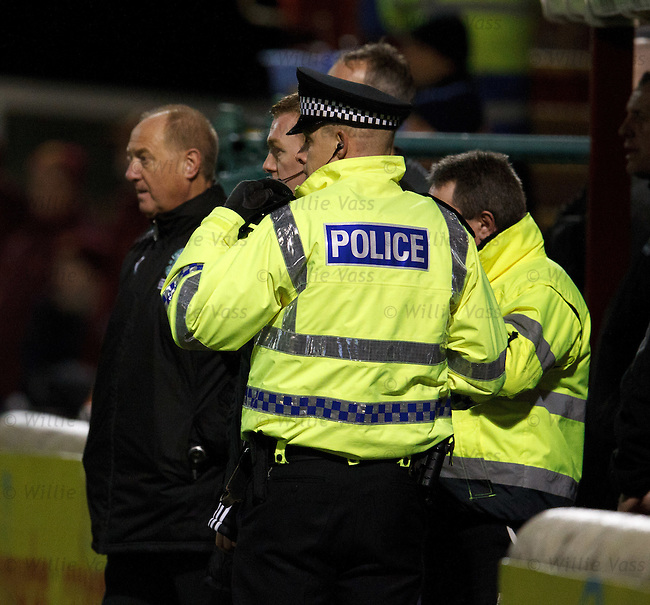 Police at the tunnel during the match watching the away stand