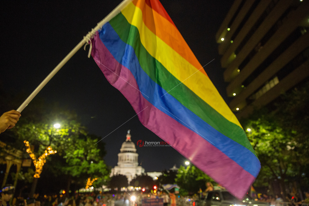 AUSTIN, TEXAS - A rainbow flag towers over the State of Texas Capitol Dome at the 2016 Austin PRIDE Parade on Saturday, Aug. 27, 2016. <br />
