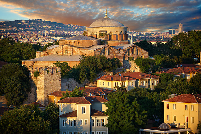 """Hagia Irene or Hagia Eirene ( , """"Holy Peace"""", Aya rini), the first Christian Roman Basilica built in Constantinople by Emperor Constantine. Rebuilt by Emperor Justinian I had the church restored in 548 and dedicated to his wife Now just inside the walls of the Topkapi Palace with the 19th century historic Ottoman houses of Soukçeme Soka in the foreground , Istanbul Turkey"""