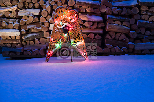 CHRISTMAS LIGHTS ON  SNOW COVERED SNOW SHOES