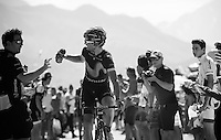A Movistar rider grabbing a last water bottle when crossing the last mountain climb of the day; the Col de Peyresourde (1569m/7.1km at 7.8%)<br /> <br /> stage 8: Pau - Bagnères-de-Luchon, 184km<br /> 103rd Tour de France 2016