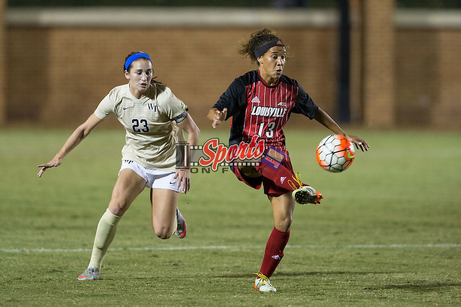 Rachel Avant (13) of the Louisville Cardinals controls the ball in front of Kendall Fischlein (23) of the Wake Forest Demon Deacons during first half action at Spry Soccer Stadium on October 31, 2015 in Winston-Salem, North Carolina.  The Demon Deacons defeated the Cardinals 2-1.  (Brian Westerholt/Sports On Film)