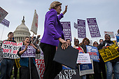 United States Senator Elizabeth Warren (Democrat of Massachusetts) takes the stage during a rally led by United States Congressional Democrats against United States President Donald J. Trump's proposed tax plan outside the United States Capitol in Washington, D.C. on November 1st, 2017.<br /> Credit: Alex Edelman / CNP