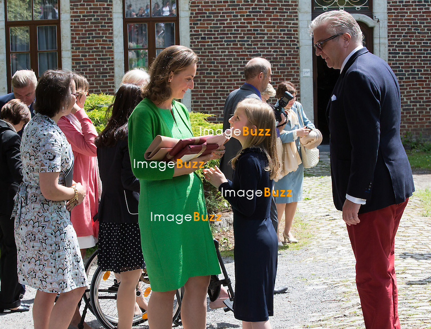 Princess Claire of Belgium, Princess Louise of Belgium, Prince Laurent of Belgium attend the first communion of twin princes Nicolas and Aymeric of Belgium, at the Sainte-Catherine church, in Bonlez, Belgium.<br /> 29 May 2014.