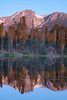 Sprague Lake's background get bathed in early morning pink light, Rocky Mountain National Park, Colorado