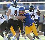 BROOKINGS, SD - NOVEMBER 5:  Kellen Soulek #94 from South Dakota State sacks quarterback Brodie Lambert #9 form Missouri State in the first half Saturday afternoon at Dana J. Dykhouse Stadium in Brookings. (Photo by Dave Eggen/Inertia)