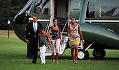 United States President Barack Obama and First Lady Michelle Obama walk with their daughters Malia and Sasha, Sunday, August 29, 2010 upon their return to the White House in Washington, DC.  The First Family completed their 10-day vacation on Martha's Vineyard and spent Sunday in Louisiana..Credit: Olivier Douliery / Pool via CNP