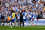 Bristol Rovers players celebrate victory in front of their fans after the 2015 Vanarama Conference Promotion Final match between Grimsby Town and Bristol Rovers at Wembley Stadium, London<br /> Picture by David Horn/eXtreme aperture photography +44 7545 970036<br /> 17/05/2015