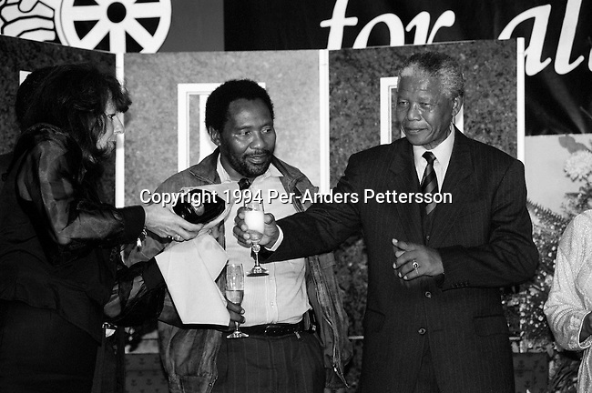 JOHANNESBURG, SOUTH AFRICA - MAY 2: Former South African president Nelson Mandela drinks champagne at a victory party held at Carlton Hotel on May 2, 1994 in Johannesburg, South Africa. The historic democratic election was held on April 27, 1994 and Mr. Mandela and his party, the African National Congress, won. Mr. Mandela became the first black democratic elected president in South Africa. He retired from office after one term in June 1999. (Photo by Per-Anders Pettersson)