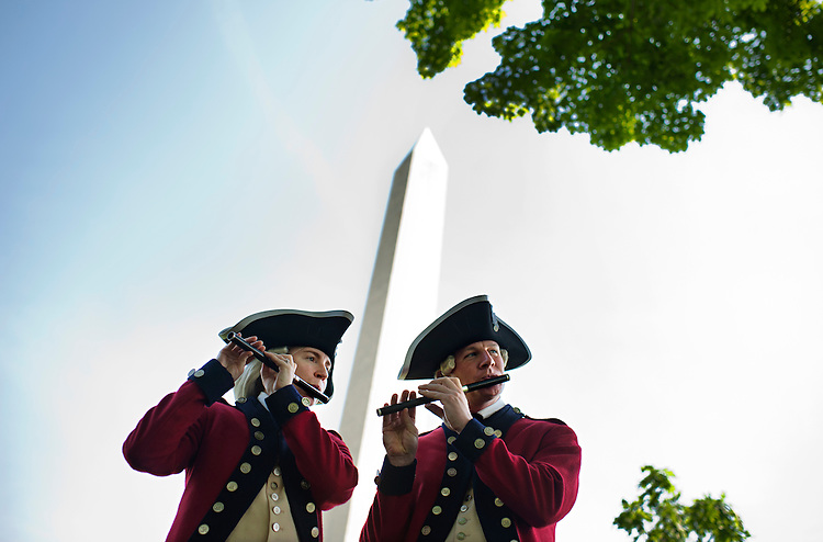 UNITED STATES - MAY 12:  Sgt. First Class Crystal Lee and Staff  Sgt. Troy Paolantonio of the U.S. Army Old Guard Fife and Drum Corps, practice on the Mall before performing at a ceremony that re-opened the Washington Monument to the public. The Monument was closed since it suffered earthquake damage in August 2011. (Photo By Tom Williams/CQ Roll Call)