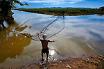 A man throws a fishing net near Pheakdei, Cambodia.