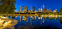 The Austin skyline reflects back into this pool of water after dark from the park near the Long Center in downtown area of the city.  Austin Skyline has been constantly changing in the last few year but you can still see some of the iconic building like the frost bank building from this location, along with the Austonian, the 360 Condos, W Hotel and many other.