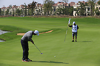 Edoardo Molinari (ITA) putts on the 9th green during Sunday's Final Round of the 2014 BMW Masters held at Lake Malaren, Shanghai, China. 2nd November 2014.<br /> Picture: Eoin Clarke www.golffile.ie