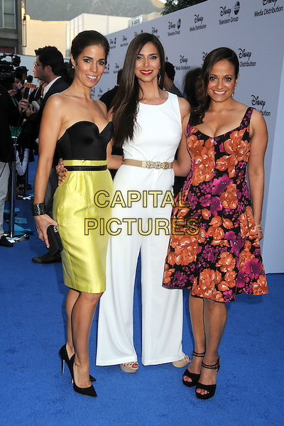 Ana Ortiz, Roselyn Sanchez, Judy Reyes.Disney Media Networks International Upfronts 2013 held at Walt Disney Studios, Burbank, California, USA..May 19th, 2013.full length black strapless top yellow skirt clutch bag orange purple pink white  jumpsuit wide flared leg trousers dress floral print .CAP/ADM/BP.©Byron Purvis/AdMedia/Capital Pictures