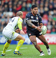 Manu Tuilagi passes the ball. Heineken Cup match, between Leicester Tigers and the Ospreys on October 21, 2012 at Welford Road in Leicester, England. Photo by: Patrick Khachfe / Onside Images