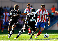 Atletico's Koke and Granada's Brahimi and Nyom during La Liga BBVA match. April 14, 2013.(ALTERPHOTOS/Alconada)