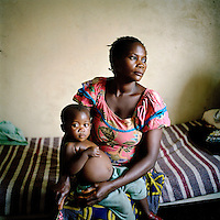 31 year old Foorar and her 18 month old baby Chiancey Mervena born as a result of her rape, in hospital in Goma. An estimated 250,000 women have been victims of sexual violence during the Democratic Republic of Congo's civil war. In the eastern states of the country a recent peace agreement struggles to keep warring factions from fighting, and as the chaos that accompanies war continues, so does the rape of women in the area..©Robin Hammond/PANOS/Felix Features