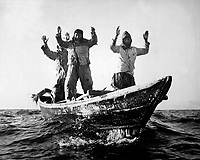 Three Korean Communists in a fishing boat are captured by the USS MANCHESTER off the coast of Korea.  May 10, 1951. (Navy)<br /> NARA FILE #:  080-G-428666<br /> WAR & CONFLICT BOOK #:  1492