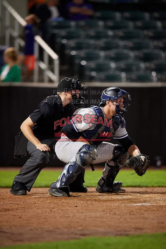 Staten Island Yankees catcher Josh Breaux (28) waits to receive a pitch in front of home plate umpire Tyler Witte during a game against the Aberdeen IronBirds on August 23, 2018 at Leidos Field at Ripken Stadium in Aberdeen, Maryland.  Aberdeen defeated Staten Island 6-2.  (Mike Janes/Four Seam Images)