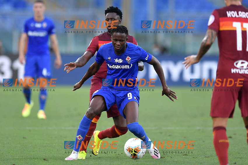 Christian Kouame of ACF Fiorentina and Amadou Diawara of AS Roma compete for the ball during the Serie A football match between AS Roma and ACF Fiorentina at stadio Olimpico in Roma (Italy), July 26th, 2020. Play resumes behind closed doors following the outbreak of the coronavirus disease. <br /> Photo Antonietta Baldassarre / Insidefoto