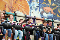 Pictured: People on the Shockwave at the fairground. Sunday, 01 June 2014<br /> Re: Celebrities v Celebrities football game organised by Sellebrity Scoccer, in aid of Swansea City Community Trust, at the Liberty Stadium, south Wales.