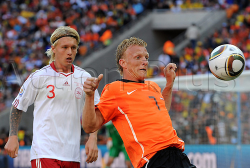 Dutchman Dirk Kuyt (R) vies for the ball with Denmark's Simon Kjaer during the 2010 FIFA World Cup group E match between the Netherlands and Denmark at Soccer City stadium in Johannesburg, South Africa, 14 June 2010.