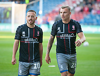 Lincoln City's Jack Payne, left, and Harry Anderson during the pre-match warm-up<br /> <br /> Photographer Andrew Vaughan/CameraSport<br /> <br /> The Carabao Cup First Round - Huddersfield Town v Lincoln City - Tuesday 13th August 2019 - John Smith's Stadium - Huddersfield<br />  <br /> World Copyright © 2019 CameraSport. All rights reserved. 43 Linden Ave. Countesthorpe. Leicester. England. LE8 5PG - Tel: +44 (0) 116 277 4147 - admin@camerasport.com - www.camerasport.com