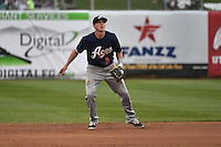 Nick Ahmed (5) of the Reno Aces on defense against the Salt Lake Bees at Smith's Ballpark on May 5, 2014 in Salt Lake City, Utah.  (Stephen Smith/Four Seam Images)