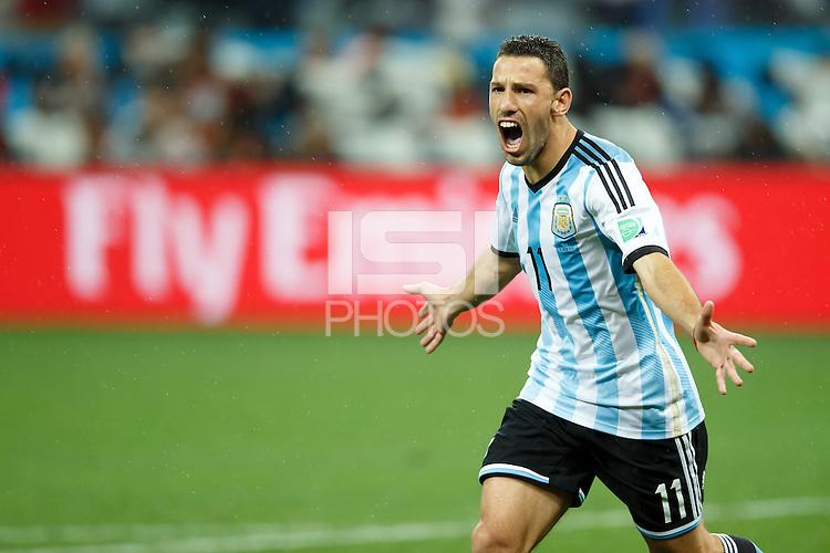 Maxi Rodriguez of Argentina celebrate scoring the winning penalty
